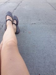 girls legs in summer on sidewalk