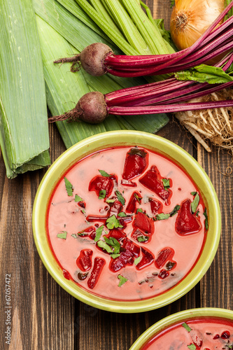 Beetroot soup with fresh vegetables in a bowl