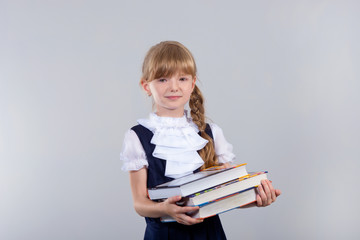 Cute beautiful schoolgirl with books