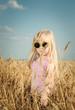 Pretty little girl in trendy yellow sunglasses