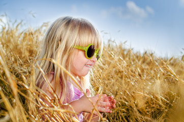 Pretty little girl in trendy yellow sunglasses