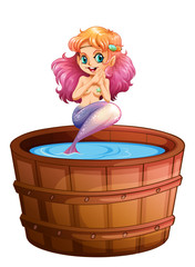 A smiling mermaid in the barrel