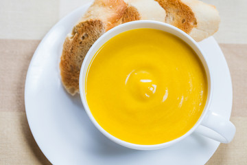 Creamy pumpkin soup with lightly toasted baguette slices