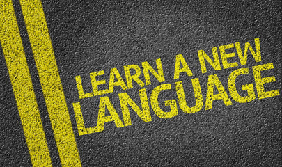 Learn a New Language written on the road