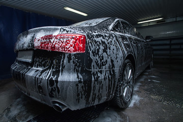 black car in foam on sink