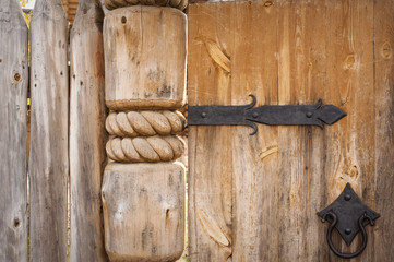 close-up of old wooden door on metal hinges