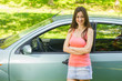 Young woman showing new car