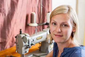 Pretty Blonde Woman At Sewing Machine