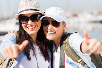 female tourists giving thumbs up