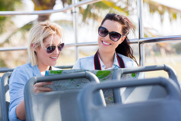 tourists travelling on a open top bus