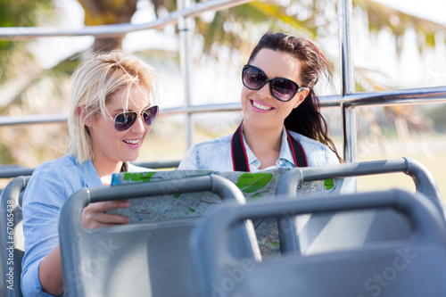 canvas print picture tourists travelling on a open top bus