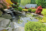 Fototapety Home tropical garden with pond