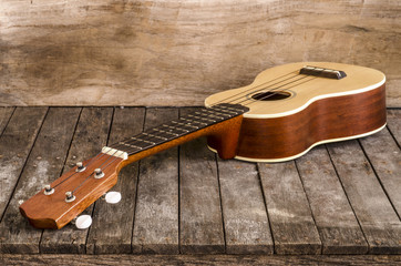 Ukulele guitar on wooden  background, Close-up shot.