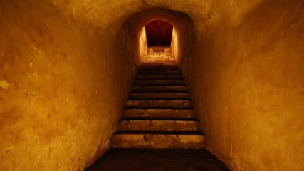 Beautiful shot of steps inside a cave.  Orange tones.