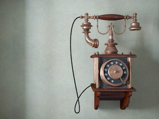 Vintage telephone on old wall concept background