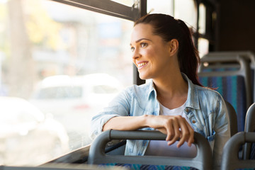 young woman taking bus to work