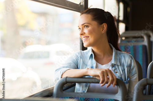 Poster young woman taking bus to work