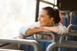 female commuter daydreaming on bus - 67066606
