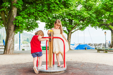 Adorable children playing on playground