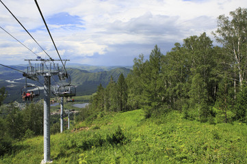 Ski lift on a background summer Altai Mountains.