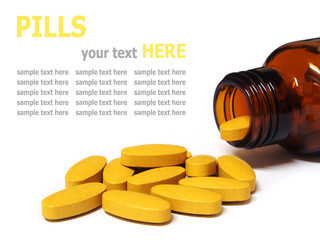 pills and bottle isolated on white background