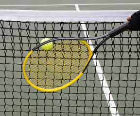 Tennis Ball into Net during game