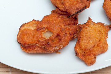 Pakora on a white plate close up