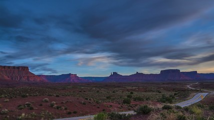 Clouds moving over the Colorado River Fisher Towers and La Sal M