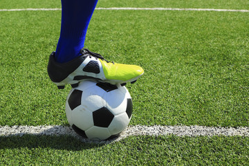 Soccer player's feet at kick