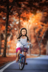 Little girl riding a bicycle in the park