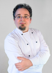 Cook chef in uniform on white