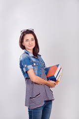 Beautiful young female student with book