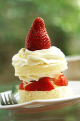 close up strawberry cake in white dish