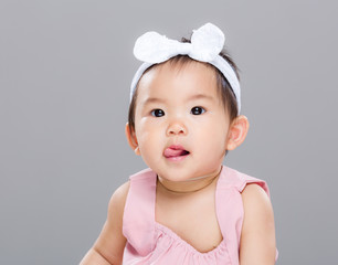 Asian baby girl show tongue