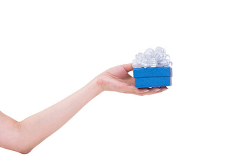 Women hand with blue gift box isolated on white background, clip