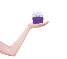 Women hand with purple gift box isolated on white background, cl