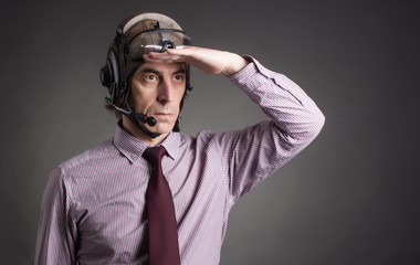 Businessman in helmet pilot looks into the distance.