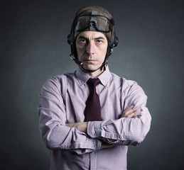 Portrait of a businessman wearing a helmet aviator.