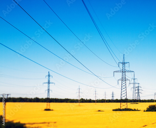 canvas print picture Power lines in the field