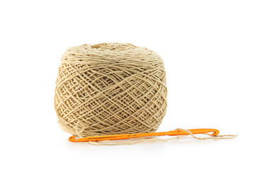 wool and orange needle on white background