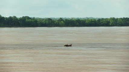 ishing boat on Mekong river, cambodia