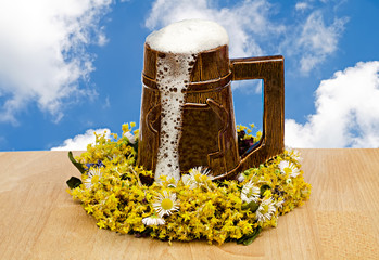 beer glass with flowers against the sky