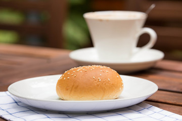 bread with sesame seeds and coffee