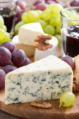 Assorted snacks and red wine, blue cheese and camembert
