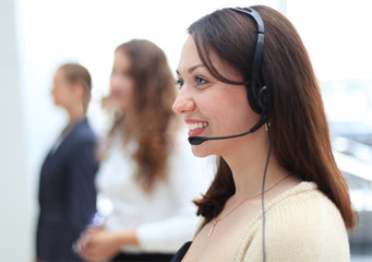Young employee working with a headset and accompanied