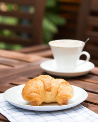 breakfast with croissants, cup of coffee