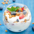 dessert with yogurt, granola, fresh berries, closeup