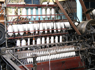 The Spools and Bobbins on a Vintage Textile Machine.