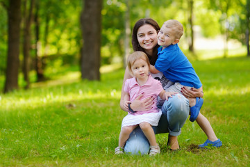 Young mother and her two adorable little kids