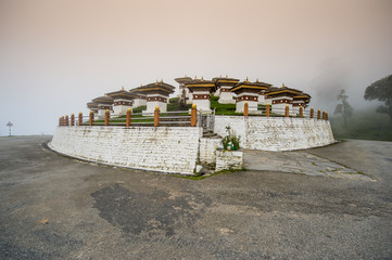 dochula stupas with Foggy day at dochula pass, bhutan